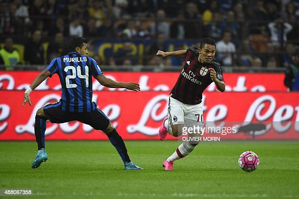 AC Milan's forward from Colombia Carlos Bacca fights for the ball with Inter Milan's defender from Colombia Jeison Murillo during the Italian Serie A...