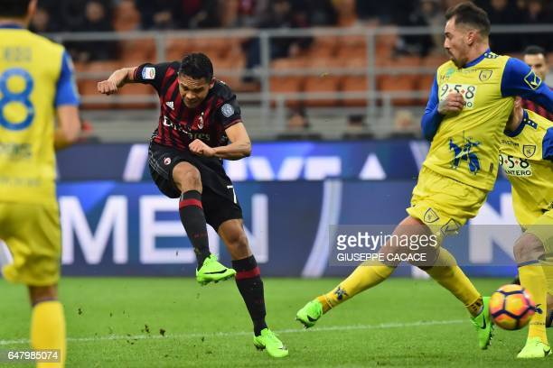 AC Milan's forward from Colombia Carlos Bacca kicks and scores during the Italian Serie A football match AC Milan vs Chievo at 'San Siro' Stadium in...
