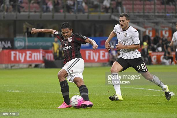 AC Milan's forward from Colombia Carlos Bacca takes a 'rabona ' trick shot in front of Palermo's midfielder from Croatia Mato Jajalo during the...