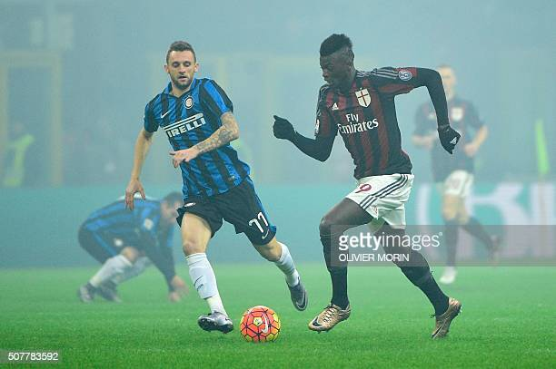 AC Milan's forward from France Mbaye Niang fights for the ball with Inter Milan's midfielder from Croatia Marcelo Brozovic during the Italian Serie A...