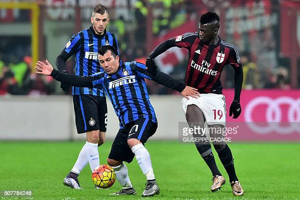 AC Milan's forward from France Mbaye Niang fights for the ball with Inter Milan's midfielder from Chile Gary Medel during the Italian Serie A...