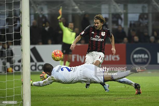 AC Milan's forward from Italy Alessio Cerci fights for the ball with Sampdoria's goalkeeper from Italy Emiliano Viviano during the Italian Serie A...