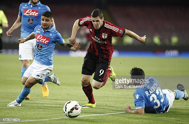 Milan's forward from Italy Mattia Destro fights for the ball with Napoli's defender from Spain Raul Albiol and Napoli's forward from Italy Lorenzo...