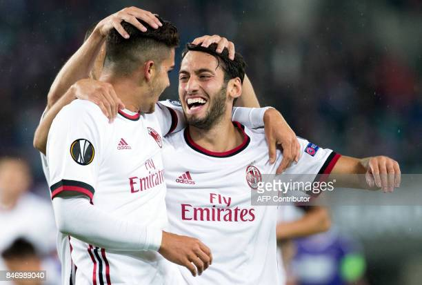 AC Milan's forward from Portugal Andre Silva celebrates scoring with midfielder from Turkey Hakan Calhanoglu during the UEFA Europa League group D...