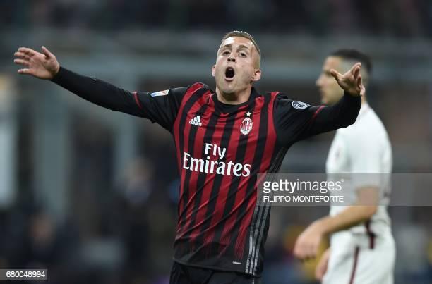 AC Milan's forward from Spain Gerard Deulofeu reacts during the Italian Serie A football match AC Milan vs AS Roma at the San Siro stadium in Milan...