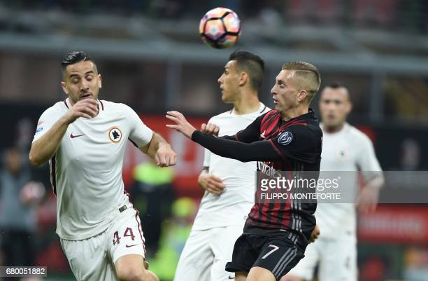 AC Milan's forward from Spain Gerard Deulofeu vies with Roma's defender from Greece Kostas Manolas during the Italian Serie A football match AC Milan...