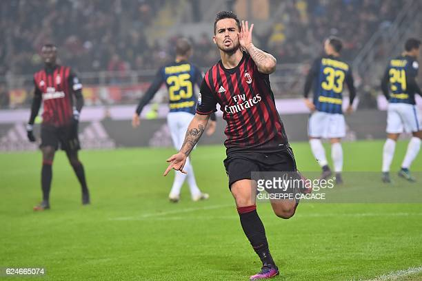 AC Milan's forward from Spain Suso celebrates after scoring during the Italian Serie A football match AC Milan Vs Inter Milan on November 20 2016 at...