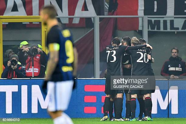 AC Milan's forward from Spain Suso celebrates with teammates after scoring during the Italian Serie A football match AC Milan Vs Inter Milan on...