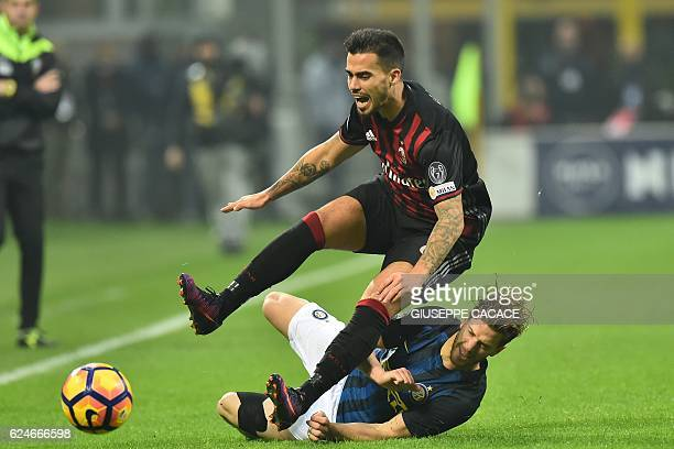 AC Milan's forward from Spain Suso fights for the ball with Inter Milan's defender from Argentina Cristian Ansaldi during the Italian Serie A...