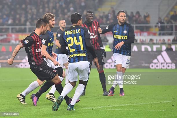 AC Milan's forward from Spain Suso kicks and scores during the Italian Serie A football match AC Milan Vs Inter Milan on November 20 2016 at the 'San...