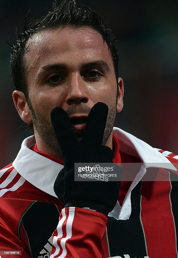 AC Milan's forward Giampaolo Pazzini celebrates after scoring against FC Bologna during their Serie A football match in Milan's San Siro Stadium on January 19, 2013.