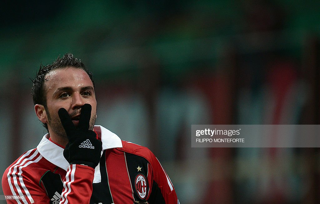 AC Milan's forward Giampaolo Pazzini celebrates after scoring against FC Bologna during their Serie A football match in Milan's San Siro Stadium on January 20, 2013.