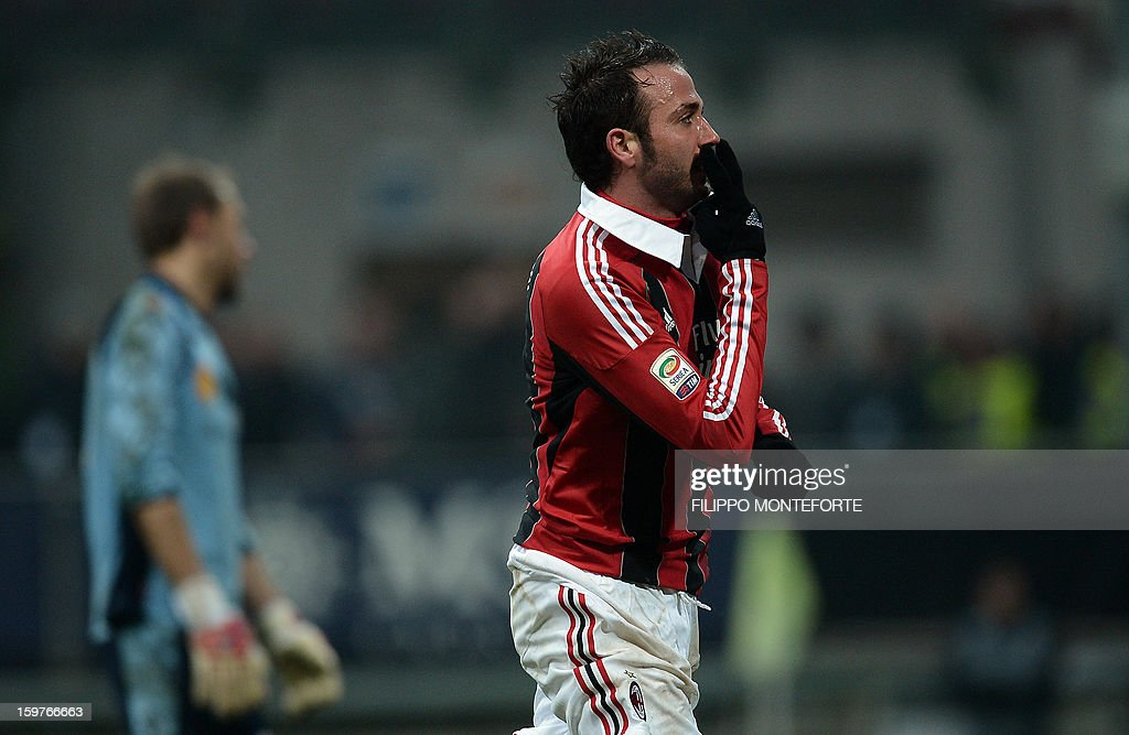 AC Milan's forward Giampaolo Pazzini celebrates after scoring against FC Bologna during their Serie A football match in Milan's San Siro Stadium on January 20, 2013. AFP PHOTO / FILIPPO MONTEFORTE