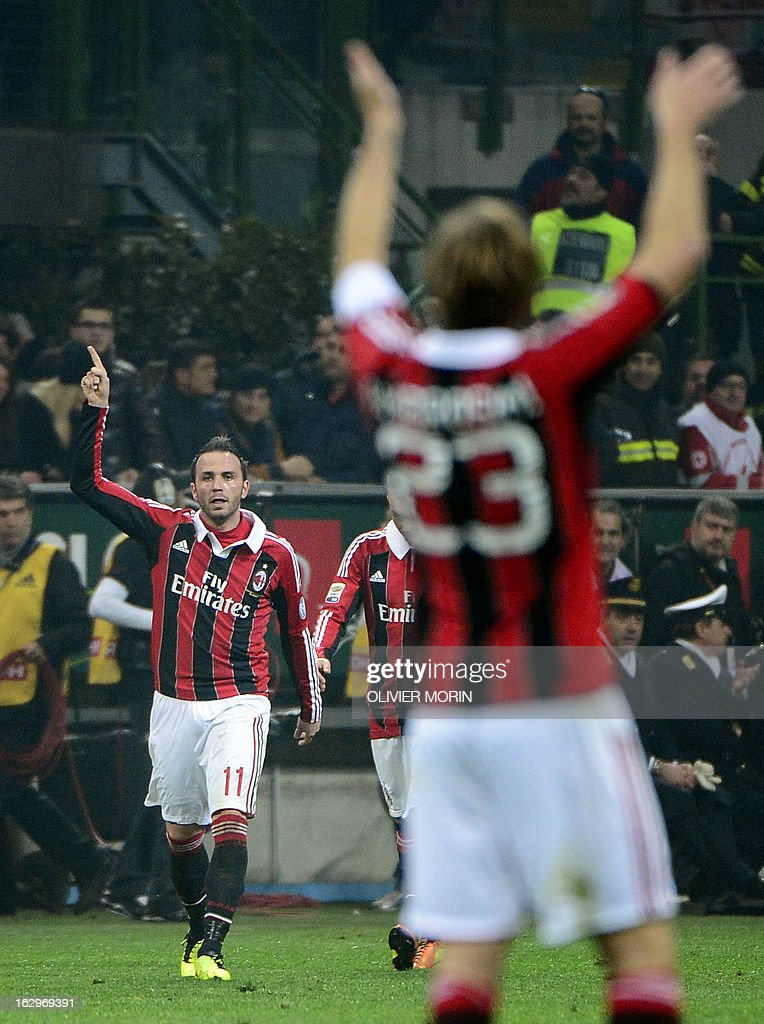 AC Milan's forward Giampaolo Pazzini (L) celebrates after scoring during the Italian Serie A match between AC Milan and Lazio on March 2, 2013 at San Siro Stadium in Milan. AFP PHOTO / OLIVIER MORIN