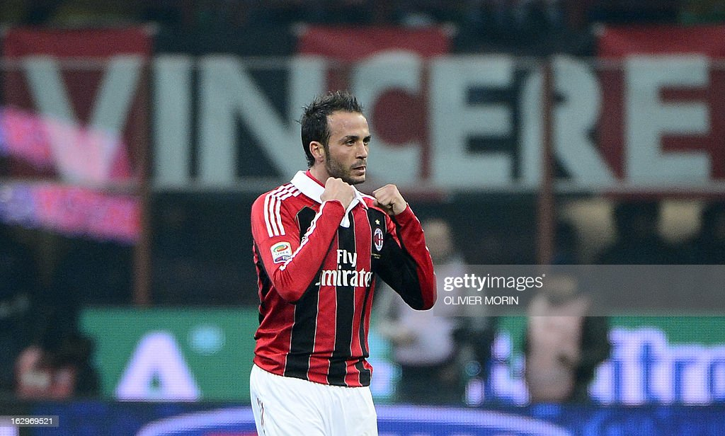 AC Milan's forward Giampaolo Pazzini celebrates after scoring during the Italian Serie A match between AC Milan and Lazio on March 2, 2013 at San Siro Stadium in Milan.