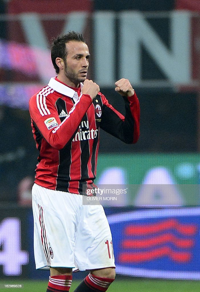 AC Milan's forward Giampaolo Pazzini (L) celebrates after scoring during the Italian Serie A match between AC Milan and Lazio on March 2, 2013 at San Siro Stadium in Milan.