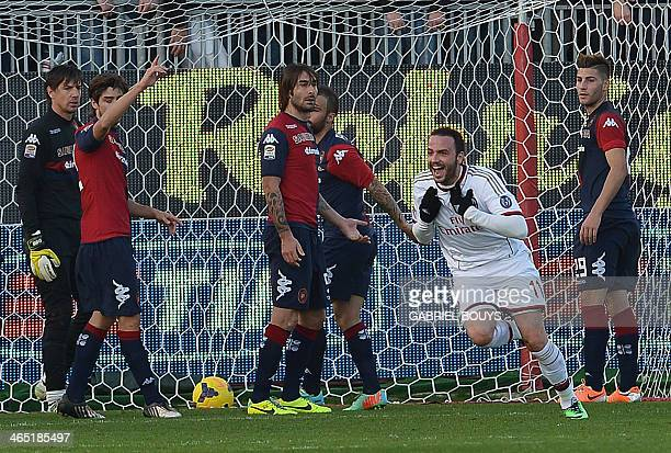 AC Milan's forward Giampaolo Pazzini celebrates after scoring during the Italian Serie A football match between Cagliari and AC Milan on January 26...
