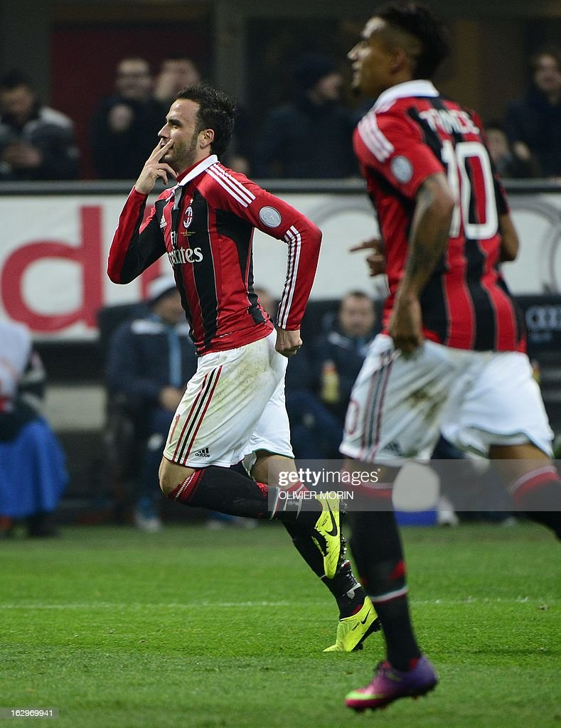 AC Milan's forward Giampaolo Pazzini (L) celebrates after scoring his second goal during the Italian Serie A football match between AC Milan and Lazio on March 2, 2013 at the San Siro stadium in Milan.