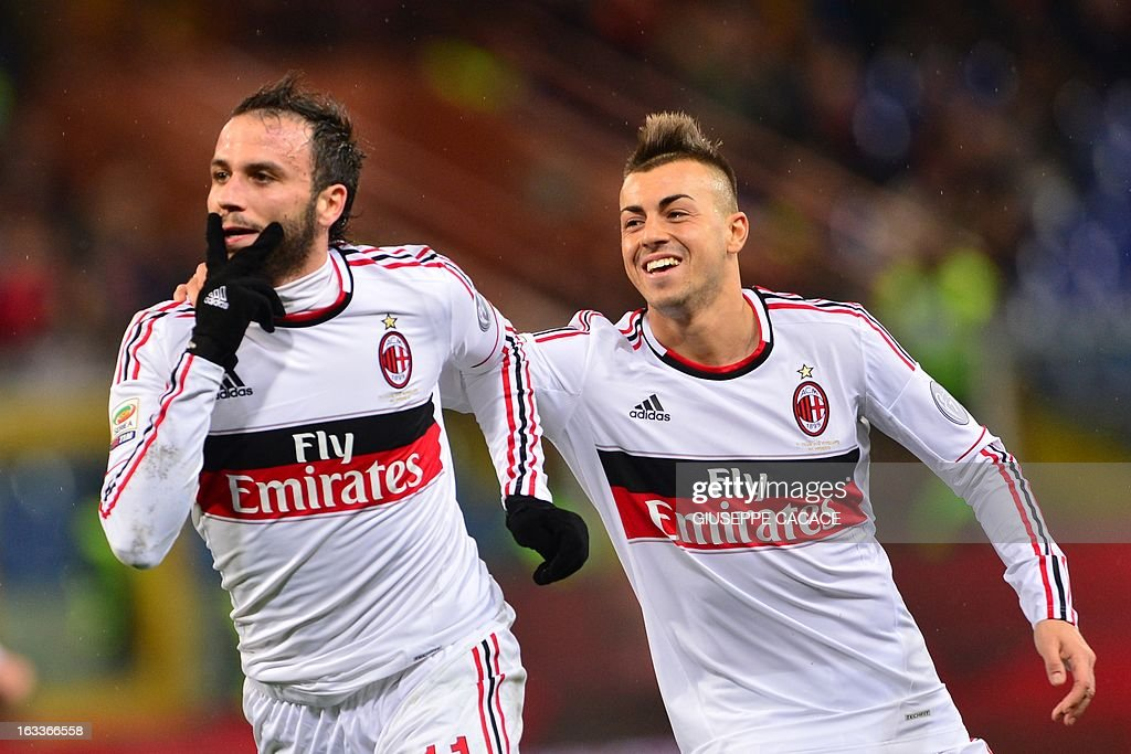 AC Milan's forward Giampaolo Pazzini (L) celebrates with AC Milan's forward Stephan El Shaarawy after scoring during the Italian championships Serie A football match Genoa vs AC Milan at the Marazzi Stadium in Genova on March 8, 2013.