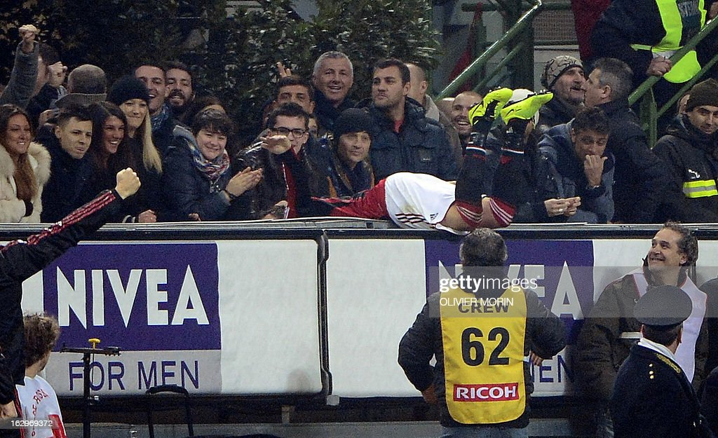 AC Milan's forward Giampaolo Pazzini jumps into the stands in celebration after scoring during the Italian Serie A match between AC Milan and Lazio on March 2, 2013 at San Siro Stadium in Milan. AFP PHOTO / OLIVIER MORIN