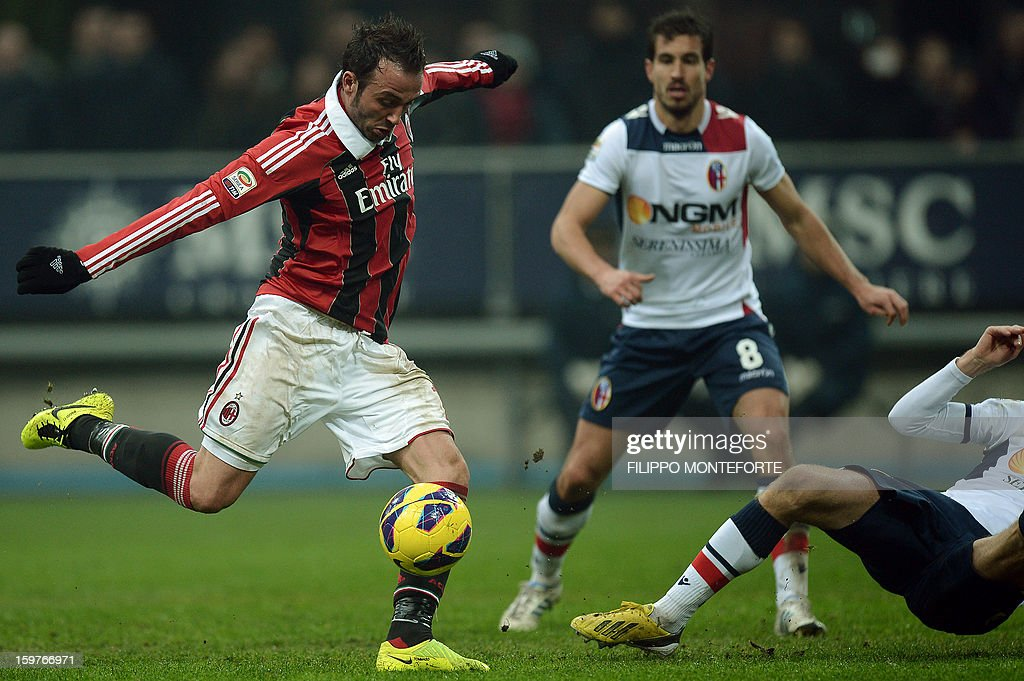 AC Milan's forward Giampaolo Pazzini (L) kicks to score against FC Bologna during their Serie A football match in Milan's San Siro Stadium on January 19, 2013.