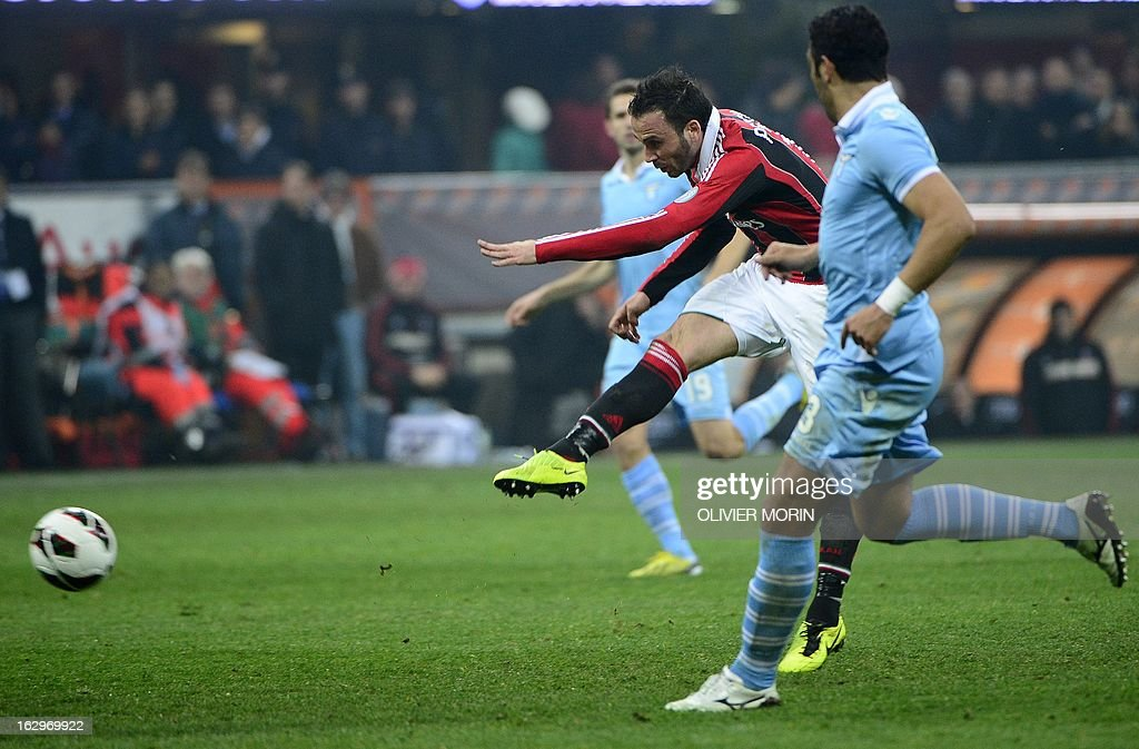 AC Milan's forward Giampaolo Pazzini (C) scores his second goal during the Italian Serie A football match between AC Milan and Lazio on March 2, 2013 at the San Siro stadium in Milan.