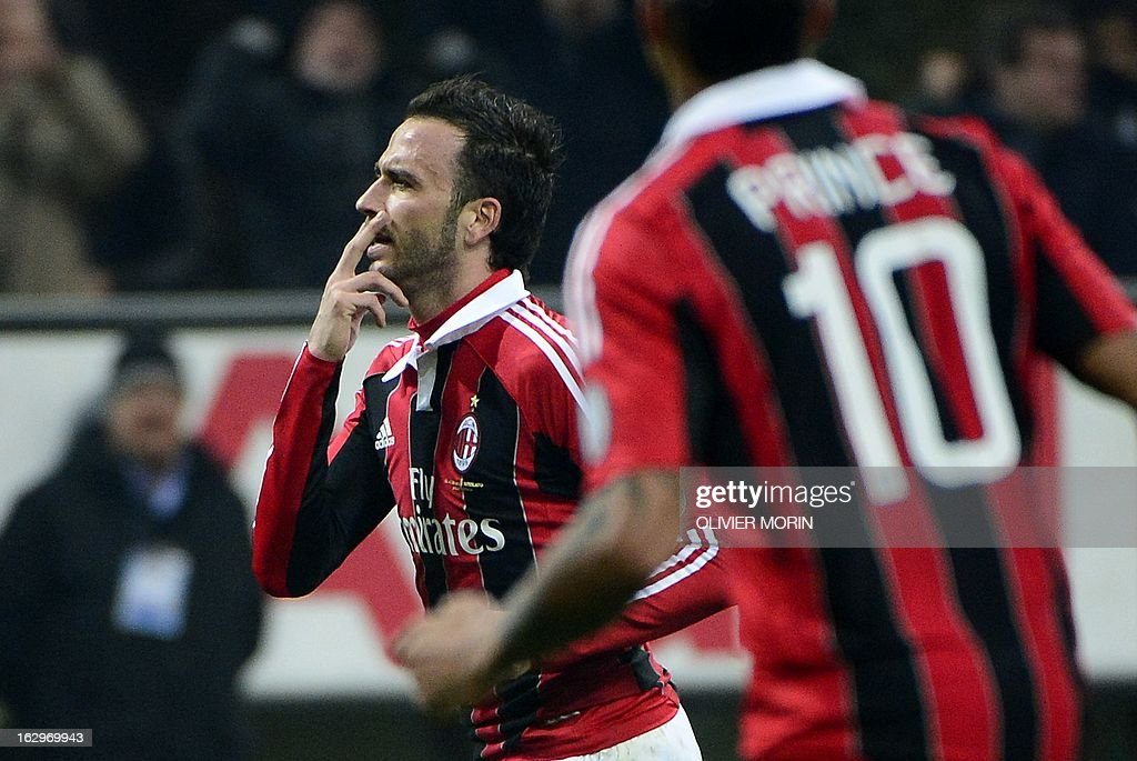 AC Milan's forward Giampaolo Pazzini (L) scores his second goal during the Italian Serie A football match between AC Milan and Lazio on March 2, 2013 at the San Siro stadium in Milan.