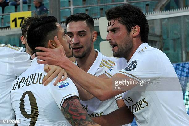 AC Milan's forward Gianluca Lapadula celebrates with teammates after scoring during the Italian Serie A football match between Palermo and AC Milan...