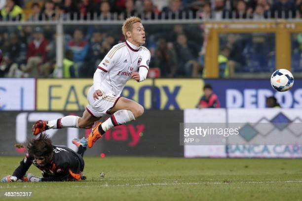 AC Milan's forward Keisuke Honda scores a goal during the Italian Serie A football match between Genoa and AC Milan on April 7 at the Luigi Ferraris...