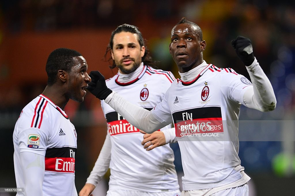 AC Milan's forward Mario Balotelli (R) celebrates after scoring a goal during the Italian championships Serie A football match Genoa vs AC Milan at the Marazzi Stadium in Genoa on March 8, 2013.