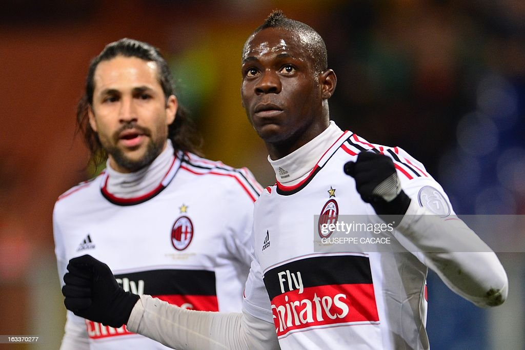 AC Milan's forward Mario Balotelli (R) celebrates after scoring a goal, next to AC Milan's Colombian defender Mario Yepes, during the Italian championships Serie A football match Genoa vs AC Milan at the Marazzi Stadium in Genoa on March 8, 2013.