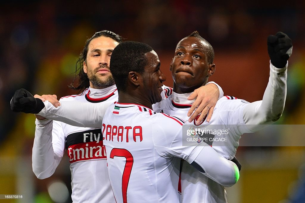AC Milan's forward Mario Balotelli (R) celebrates after scoring a goal with AC Milan's Colombian defender Cristian Zapata (C) and AC Milan's Colombian defender Mario Yepes during the Italian championships Serie A football match Genoa vs AC Milan at the Marazzi Stadium in Genoa on March 8, 2013. AFP PHOTO / GIUSEPPE CACACE
