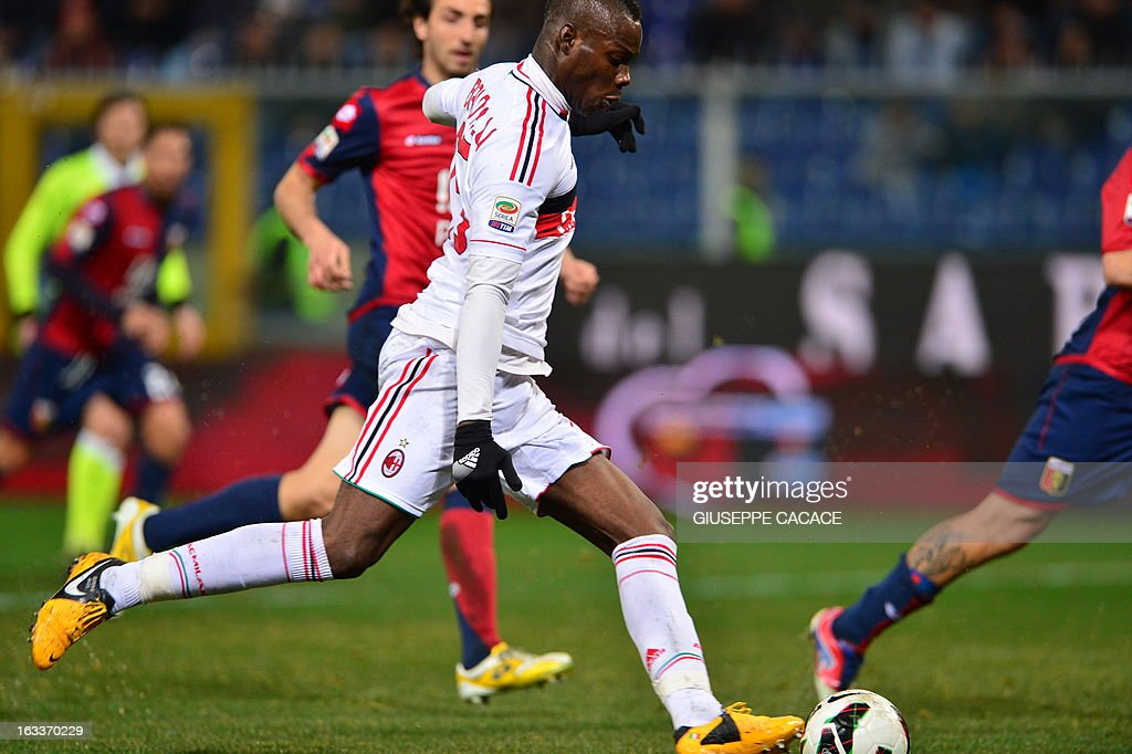 AC Milan's forward Mario Balotelli kicks and scores during the Italian championships Serie A football match Genoa vs AC Milan at the Marazzi Stadium in Genoa on March 8, 2013. AFP PHOTO / GIUSEPPE CACACE