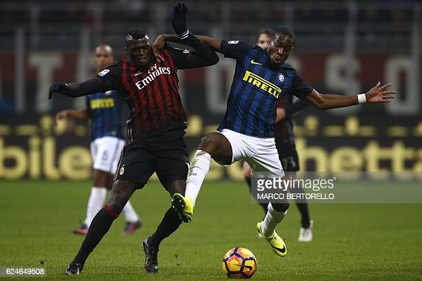 AC Milan's forward Mbaye Niang of France fights for the ball with Inter Milan's midfielder Geoffrey Kondogbia from France during the Italian Serie A...