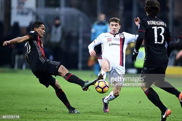 AC Milan's forward of Colombia Carlos Bacca vies with Cagliari midfielder from Italy Nicolo Barella during the Italian Serie A football match AC...