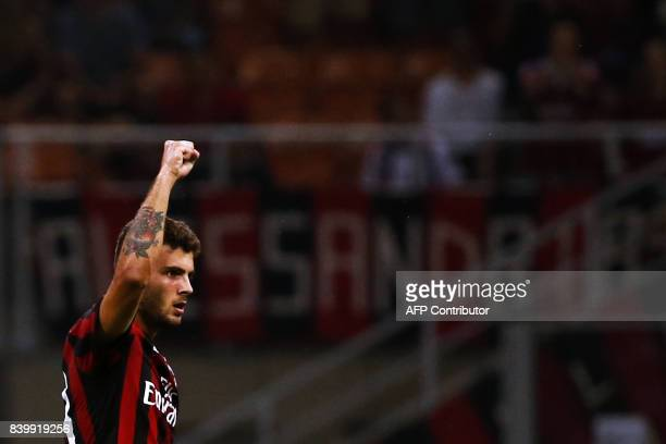 AC Milan's forward Patrick Cutrone celebrates after scoring during the Italian Serie A football match AC Milan Vs Cagliari on August 27 2017 at the...