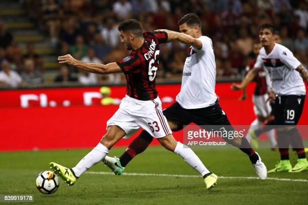 AC Milan's forward Patrick Cutrone scores a goal during the Italian Serie A football match AC Milan Vs Cagliari on August 27 2017 at the 'Giuseppe...