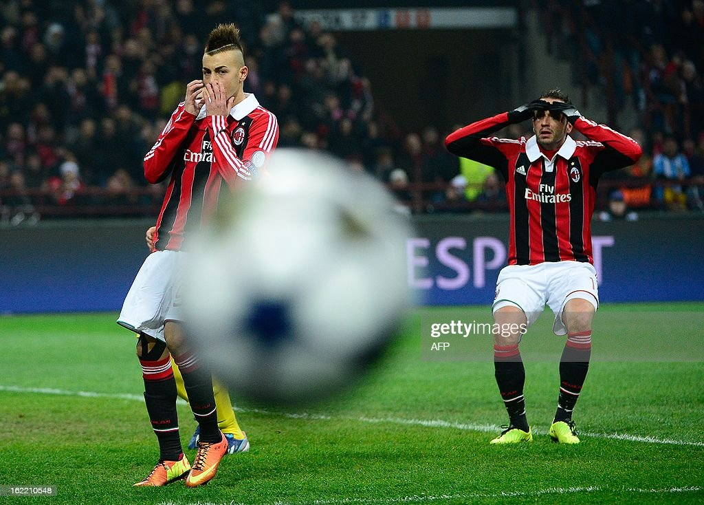 AC Milan's forward Stephan El Shaarawy (L) and AC Milan's forward Giampaolo Pazzini react after missing a goal opportunity during the Champions League football match between AC Milan and FC Barcelona on February 20, 2013 at San Siro Stadium in Milan.