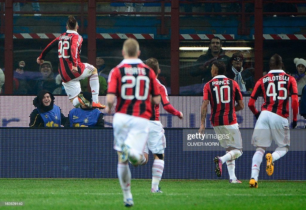 AC Milan's forward Stephan El Shaarawy (L) celebrates after scoring during the Italian serie A football match between Inter Milan and AC Milan on February 24, 2013 in Milan, at the San Siro stadium . AFP PHOTO / OLIVIER MORIN
