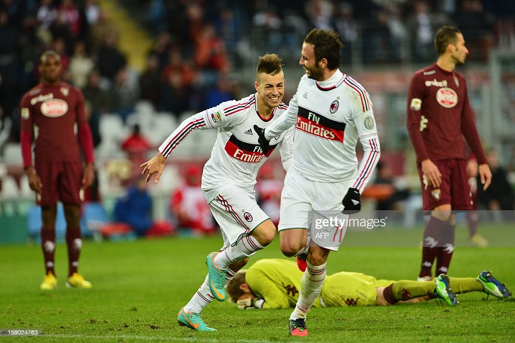 AC Milan's forward Stephan El Shaarawy (L) celebrates after scoring with AC Milan's forward Giampaolo Pazzini during the Italian Serie A football match between Torino and AC Milan at the Olympic Stadium in Turin on December 9, 2012.