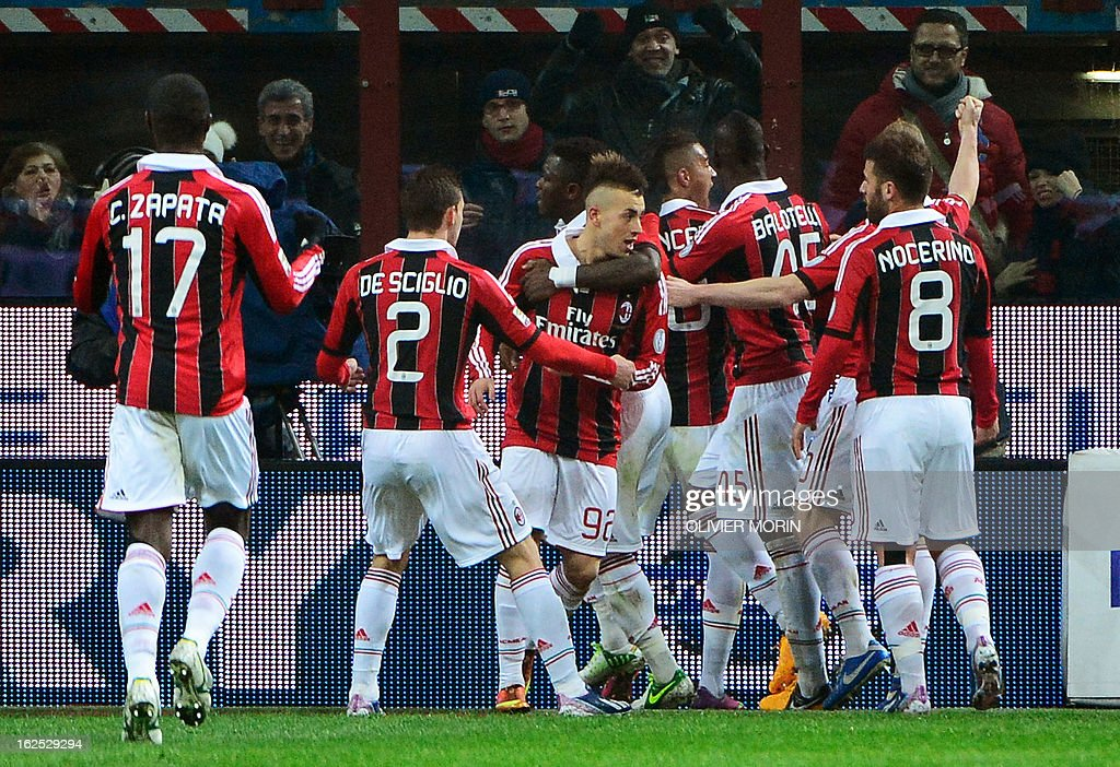 AC Milan's forward Stephan El Shaarawy (C) celebrates with teammates after scoring during the Italian serie A football match between Inter Milan and AC Milan on February 24, 2013 in Milan, at the San Siro stadium . AFP PHOTO / OLIVIER MORIN
