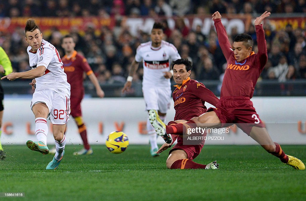 AC Milan's forward Stephan El Shaarawy (L) kicks the ball during the Italian Serie A football match between AS Roma and AC Milan on December 22, 2012, at the Olympic stadium in Rome.
