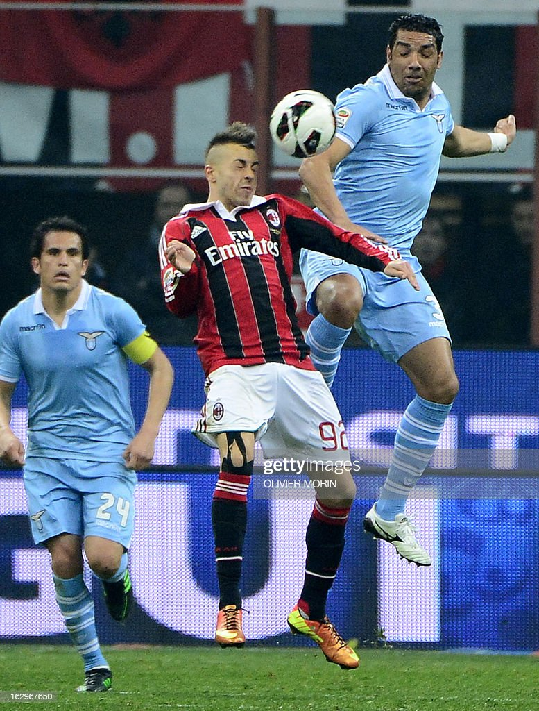AC Milan's forward Stephan El Shaarawy (C) vies for the ball with Lazio's Andre Dias (R) during the Italian Serie A match between AC Milan and Lazio on March 2, 2013 at San Siro Stadium in Milan.