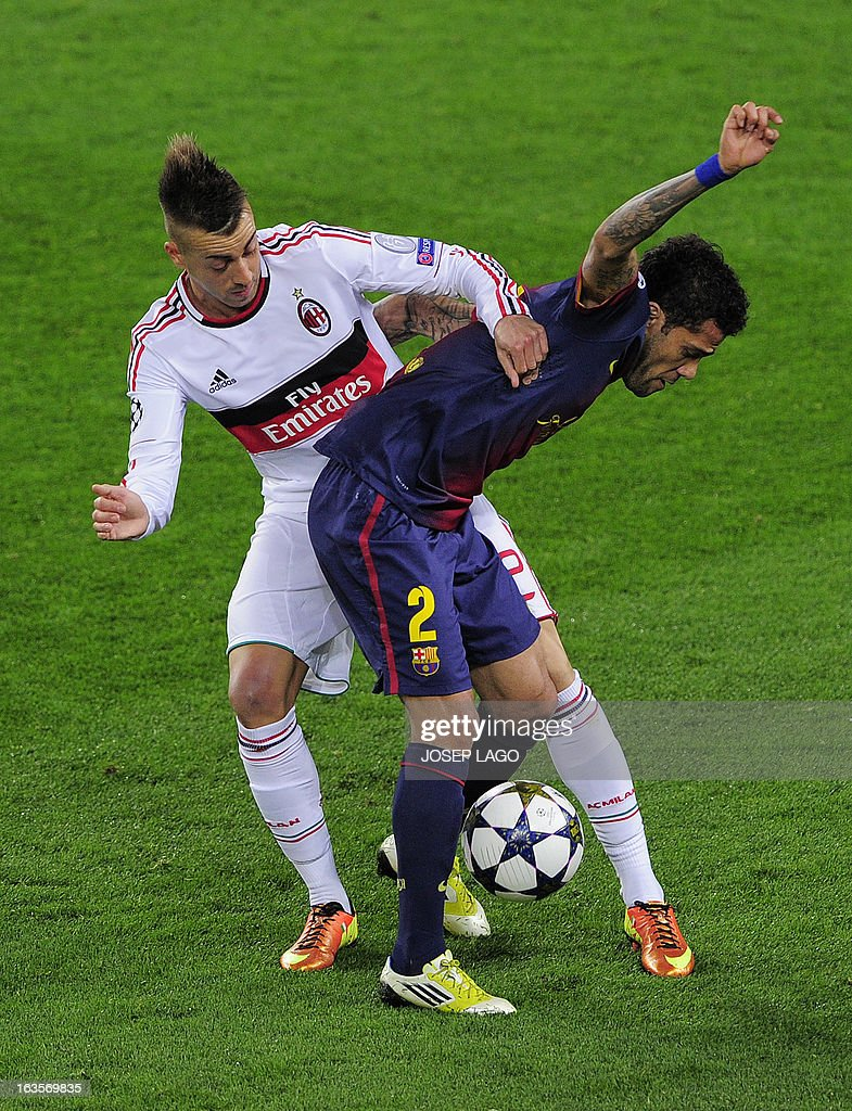 AC Milan's forward Stephan El Shaarawy (L) vies with Barcelona's Brazilian defender Daniel Alves (R) during the UEFA Champions League round of 16 second leg football match FC Barcelona against AC Milan at Camp Nou stadium in Barcelona on March 12, 2013.