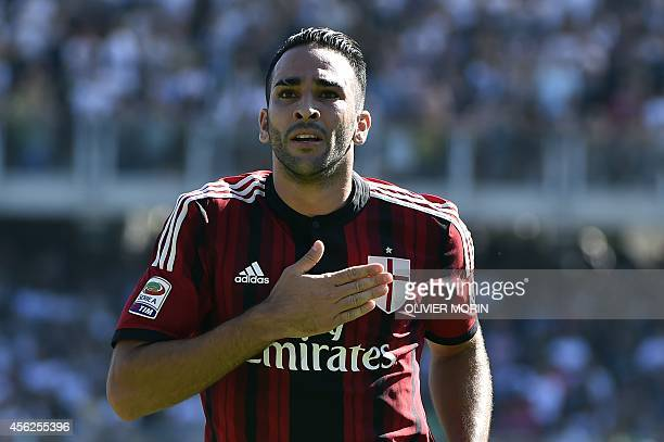 AC Milan's French defender Adil Rami celebrates after scoring during the Italian Serie A football match Cesena vs AC Milan on Septembre 28 at Dino...
