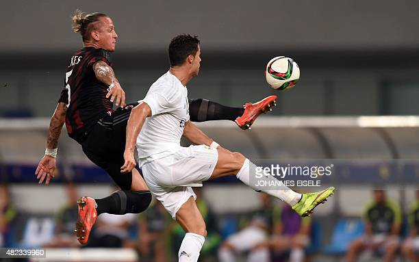 AC Milan's French defender Philippe Mexes and Real Madrid's Portuguese forward Cristiano Ronaldo vie for the ball during the International Champions...