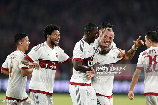 AC Milan's French defender Philippe Mexes celebrates with team mates after scoring a goal during the International Champions Cup football match...