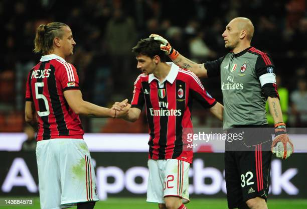 AC Milan's French defender Philippe Mexes goalkeeper Christian Abbiati and midfielder Mattia De Sciglio celebrates after the Italian seria A match...