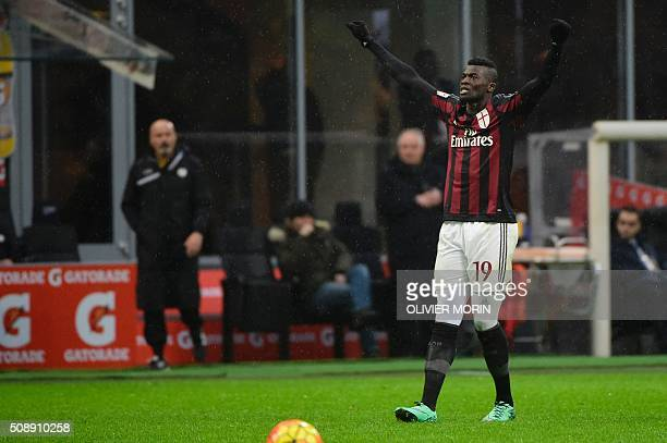 AC Milan's French forward Mbaye Niang celebrates after scoring during the Italian Serie A football match between AC Milan and Udinese at San Siro...
