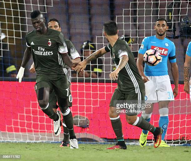 Milan's French forward M'Baye Niang celebrates after scoring during the Italian Serie A football match SSC Napoli versus AC Milan on August 27 2016...